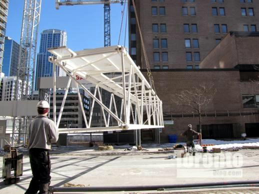 Construction crane installation at Womens College Hospital
