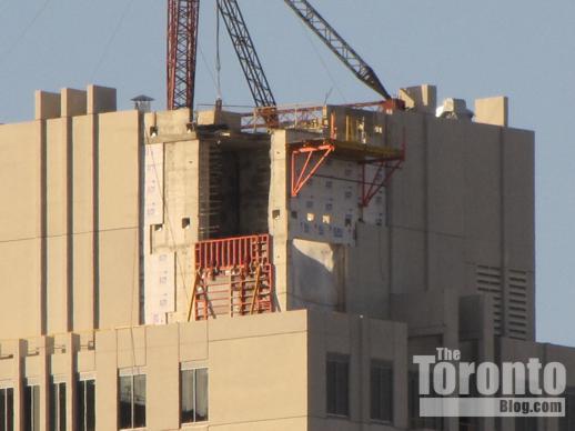 Uptown Residences condo construction crane