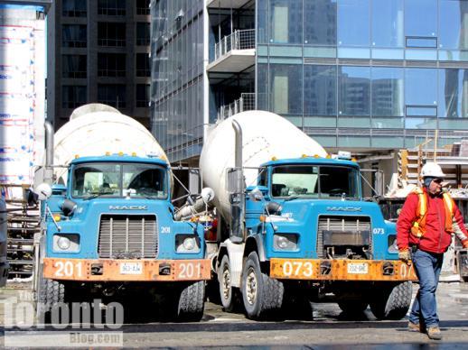 big mack trucks delivering concrete to construction sites Mack Trucks two big mack concrete trucks