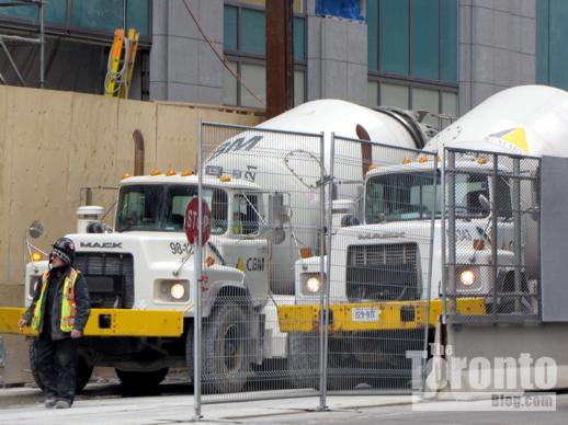 2 big Mack concrete trucks