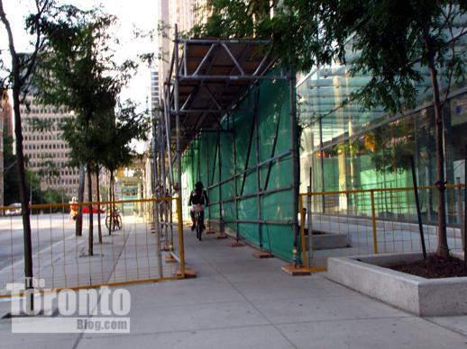 Scaffolding above Bay Street sidewalk outside Murano