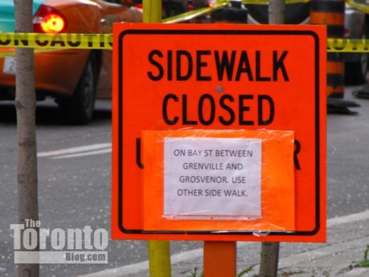 sidewalk closure sign on Bay Street