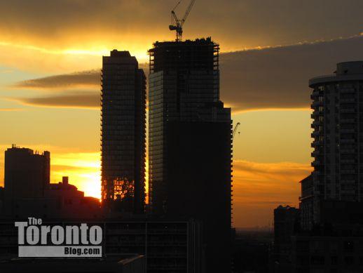 Burano condo tower and crane at sunset