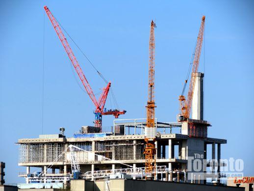 Aura condo construction crane and SickKids Tower